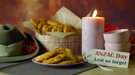 Traditional ANZAC biscuits for ANZAC Day and Remembrance Day memorial holidays in vintage style setting with Australian army slouch hat.