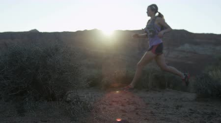 ambition : slow motion of girl trail running in desert