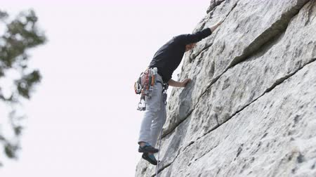 крайняя местности : Man rock climbing with a lot of gear