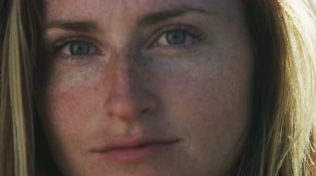 breezy : Portrait of young  woman with freckles and blue eyes