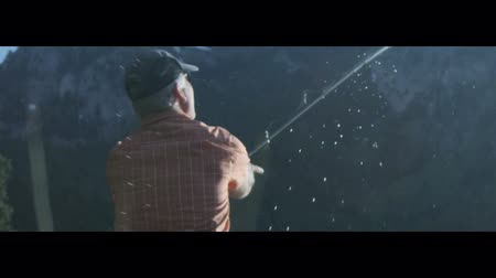 hrdý : Slow motion of Man casting reel while fishing