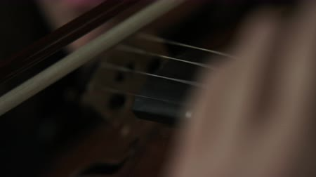 string instrument : close up of bow as girl plays violin Stock Footage