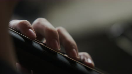 houslista : close up of fingers on string of cello