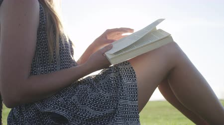 profile of woman reading book in park Stock Footage