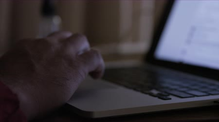 close up of hands working on laptop