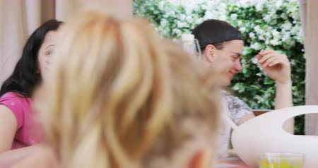 casado : family eating dinner together enjoying each others company Stock Footage