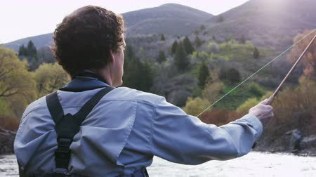 ужение : man casting as he fly fishes in Utah river
