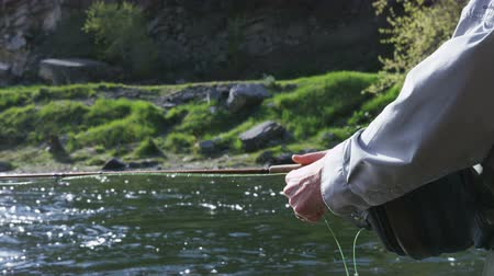 fishing pole : close up of hand casting while fishing