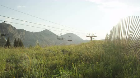winda : landscape of chair lift with mountains in background in summer near Alta, Utah
