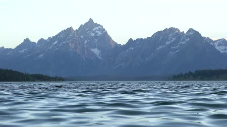 grand tetons : landscape of Grand Tetons with water rippling in foreground
