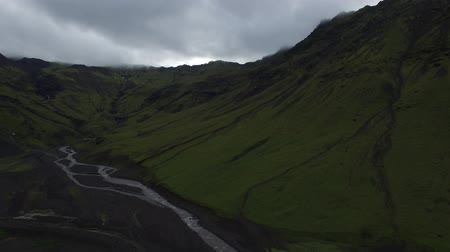 крайняя местности : drone shot of confluence of waterfalls into mountain river in Iceland