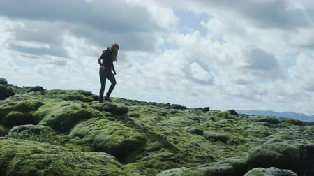 bumps : Woman hiking through moss field in Iceland