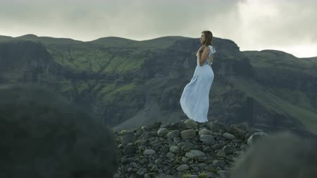 rüya gibi : Woman in dress standing in the wind in Iceland