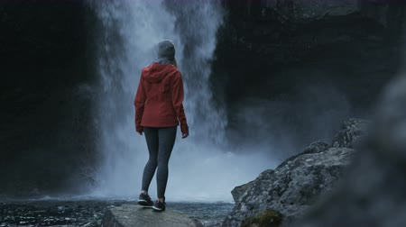 zadnice : woman tourist in Iceland taking in view next to waterfall