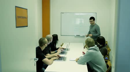 programmers : The Man Explains The Task Small Group. Paints And Shows On The Board. Stock Footage