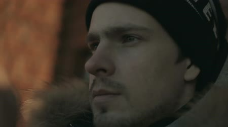 закрывать : Young man in a cap. The face close up. Winter. Стоковые видеозаписи