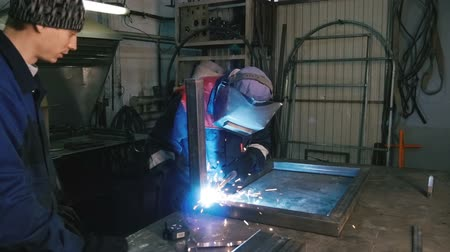 metal worker : Man works with the welding machine. Close-up.