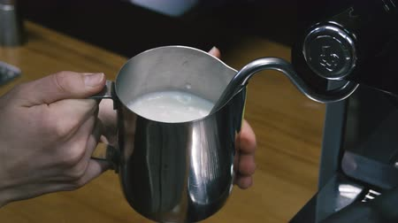 buharlama : Preparing the coffee creamer. Close-up.