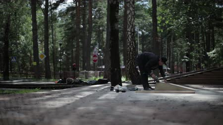 obsessive : man grinds to the construction in the skatepark Stock Footage