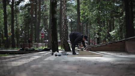 obsessive : man polishing a goods from wood in the skatepark