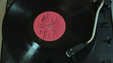 grammophone : Vinyl disc is spinning in the gramophone close-up Stock Footage