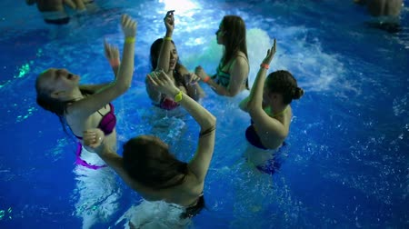 tweak : Females dancing at a party in the pool