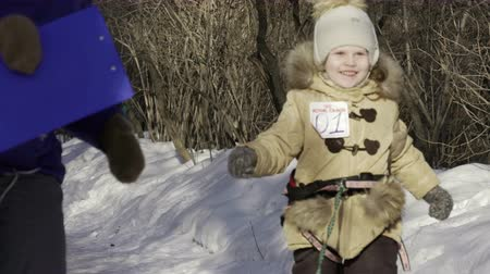 çekim : Children competition running with their dogs in winter Stok Video