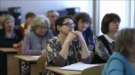 лекция : Females listen to a lecture sitting in a classroom