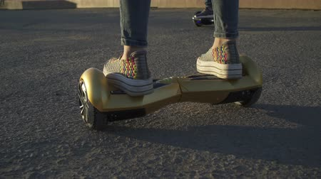 pil : Girl riding on hoverboard close up