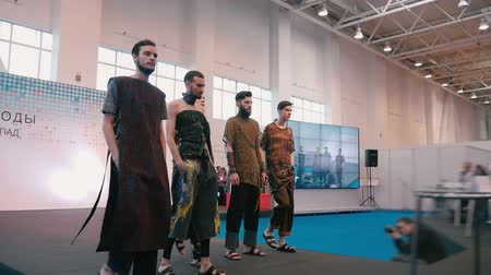 milan : Fashion show. Male model in the dresses go on the catwalk in slow motion