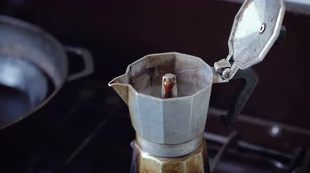 coffee grounds : Locked down close up - Coffee brewing in stove top Italian moka pot