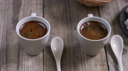 ristretto : Two cups of hot coffee
