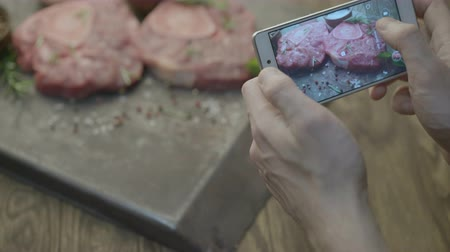 pic : take photo of steak on phone close-up Stock Footage