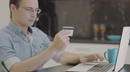 ebay : man suit inserting credit card number on laptop Stock Footage