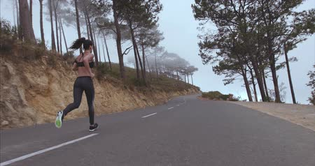 jogging : Female runner running outdoor in morning. Fitness woman exercising on countryside road.