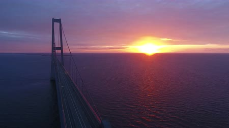 dánia : Flying over Storebaelt bridge on sea in Denmark. View of large cable bridge over ocean.