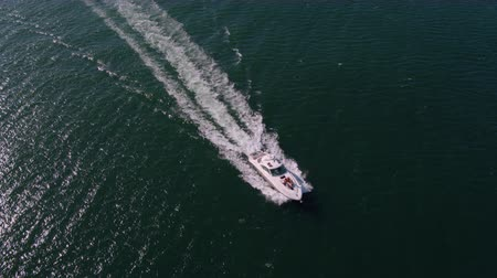 View from drone of young people on a yacht deck. Group of friends on a yacht deck having party. Stok Video