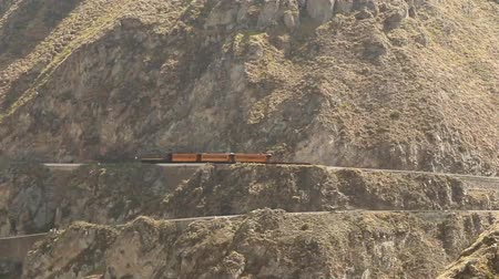 el train : Ecuadorian train passing through Nariz Del Diablo, very popular tourist attraction in Andes due to the difficulty of the route. Stock Footage