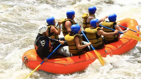 extremo : White water rafting on the rapids of the river Patate,Ecuador. Slow motion,LR Pan,handheld