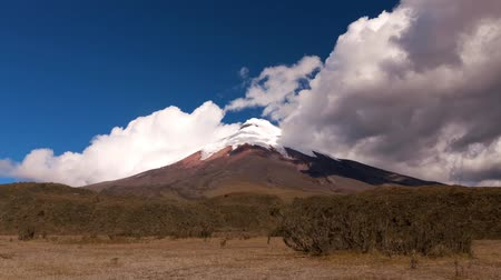 Эквадор : Fast moving clouds over the Cotopaxi volcano in Ecuador 5897m 19347ft, the second highest summit in the country. 1frame each 6s Стоковые видеозаписи