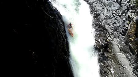 kayak : Duende waterfall jump in kayak in Ecuadorian rainforest. HD with audio.
