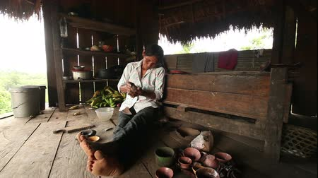 alkotás : Adult woman making pottery , rural scene in ecuadorian Amazonia