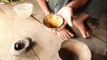 alkotás : Woman hands making pottery , rural scene in ecuadorian Amazonia