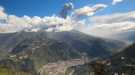 andy : Banos de Agua Santa, popular touristic destination in Ecuador and Tungurahua volcano erupting in the background, 45 minutes time lapse.