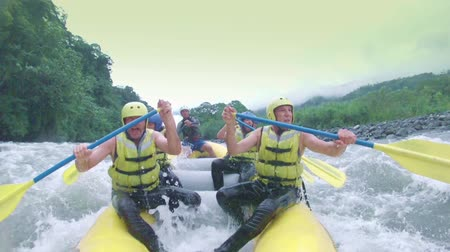 evezés : Team of six people white water rafting. Onboard camera.