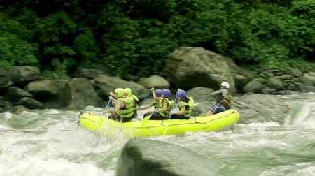 evezés : Team of six people white water rafting. Onboard and external camera. Stock mozgókép