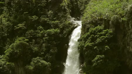 agua : Large waterfall in Ecuadorian Andes near city of Banos De Agua Santa Stock Footage