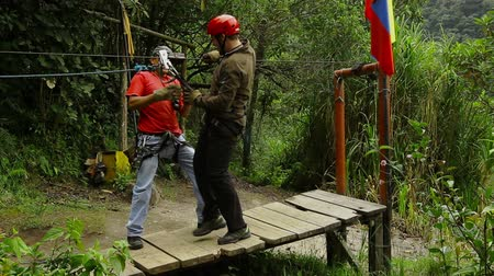 improvised : Zipline or canopy braking system, camera pans from left to right revealing the braking system Stock Footage