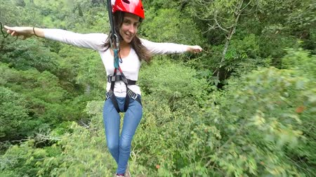 equador : Young women on zip line over the dense rainforest , 3rd person camera Vídeos
