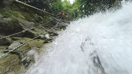 agua : Slow motion shot of canyoning trip, show from below, slow motion 120fps, perfect B roll footage